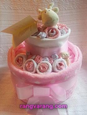 تزیین کیک پوشک با عروسک و حوله کودک